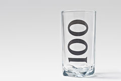 100 glass. Isolated empty 100 glass with light shadow Royalty Free Stock Photos