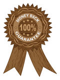 100 % GUARANTEE. Medal wooden texture Stock Photography