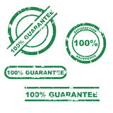 100% guarantee stamp set. Set of four green 100% guarantee grunge stamp isolated on white.EPS file available stock illustration