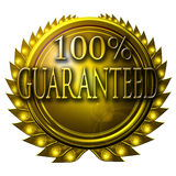 100% guaranteed. Golden medal with 100% guaranteed written on it Stock Photos