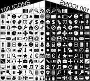 100 iconos blancos y negros del Web y de las aplicaciones Fotos de archivo libres de regalías