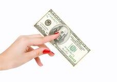 $ 100 im Arm der Frauen Stockfotografie