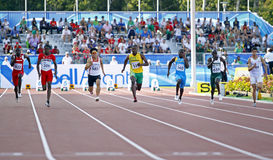 100 metres men seven runners. MONCTON, CANADA - JULY 21: Semifinals of the men's 100 metres at the 2010 IAAF World Junior Championships on July 21, 2010 in Stock Photo