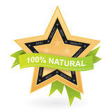 100% natural promotional sign - gold star w. Ith green ribbon Royalty Free Stock Photos