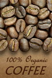 100% Organic Coffee. Coffee beans text 100% Organic Coffee  on brown background Stock Image