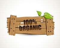 100% Organic - wooden bio icon. With leaves and waterdrops Royalty Free Stock Image