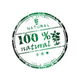 100 percent natural. Abstract grunge rubber office stamp with small stars, small plant and the text 100 % natural written in the middle royalty free illustration