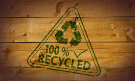 100 Percent Recycled. Stamp on wooden background Stock Photo