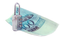 100 real brazilian money and closed padlock. Isolated on white royalty free stock images