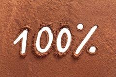 100% som skrivs med kakaopulver Fotografering för Bildbyråer