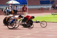 100 tester di corsa della sedia a rotelle degli uomini Fotografia Stock Libera da Diritti