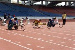 100 tester di corsa della sedia a rotelle delle donne Fotografia Stock Libera da Diritti
