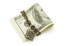 100 US dollars bills - safe and secured. 100 US dollars chained and locked on white background Stock Photos