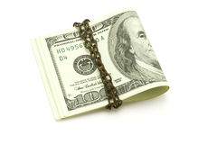 100 US dollars securely chained. 100 US dollars chained on white background Royalty Free Stock Photo