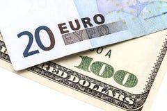 100 USD y EUROS 20 Foto de archivo libre de regalías