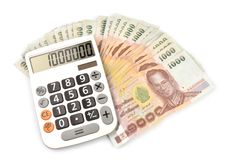 1000 baht banknotes and calculator. Isolated on white background Royalty Free Stock Photo