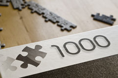 1000 pieces. Puzzle of 1000 pieces on a table Royalty Free Stock Image