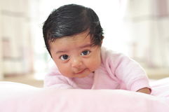 100day baby girl with big eye look at camera Stock Images