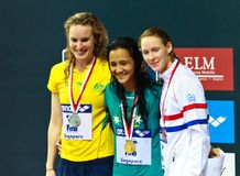 100m Freestyle medalists. Singapore - Oct. 17: Gold medalist Kotuku Ngwati (AUS), Silver medalist Marieke Guehrer (AUS), bronze medalist H. Schreuder (NED) for Stock Photography