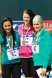 100m IM medalists. Singapore - Oct. 17: 100m IM medalists of the 2010 Fina Swimming World Cup. Gold medalist Julia Smit (USA), silver medalist (Kotuku Ngwati ( royalty free stock image