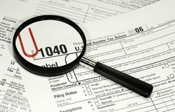 1040. Photo of 1040 IRS form and a Magnifying Glass - Tax Related Royalty Free Stock Image