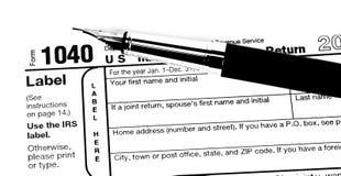 1040 de vorm van de belasting met pen Stock Foto