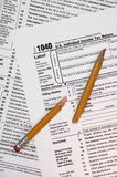 1040 Federal Tax Form, Broken Pencil on Forms. Broken pencil creates symbolic metaphor with the frustration of doing taxes. As they say, Death and Taxes royalty free stock images