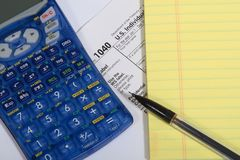 1040 form. Calculator, pad, and pencil Stock Photography