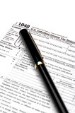1040 income tax form and a pen Royalty Free Stock Photos