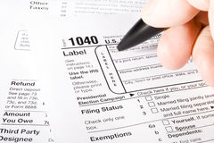 1040 Tax Form. Stock image of man filling out 1040 Tax form Stock Photography
