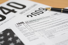 1040 Tax Prep. Close up view of 2009 American tax forms with ball point pen Stock Photo