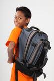 11个种族愉快的背包男小学生佩带的年 免版税库存图片
