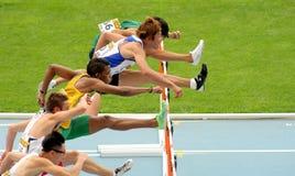 Конкуренты барьеров в 110 метров Стоковое фото RF
