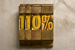 110 Percent. The word 110% done in gold letterpress type stock images