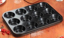 12个杯子松饼锡 图库摄影
