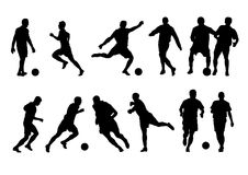12足球运动员剪影 免版税图库摄影