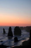 12 Apostles Sunset. Image taken of the 12 Apostles on the Great Ocean Road in Victoria Australia at sunset time with a slight part of the moon showing Stock Photography