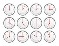 12 clocks. An image of 12 clocks with different time Stock Photography