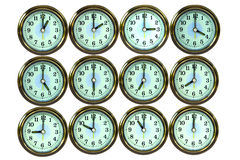 12 color gold time clocks ,. Color gold clock , at tell 12 all time times Stock Photos