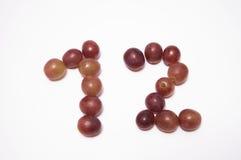 12 con las uvas Imagen de archivo libre de regalías