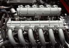 12 cylinder race car engine. Flat 12 cylinder engine used in exotic Italian sports car Royalty Free Stock Photos