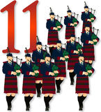 12 Days of Christmas: 11 Pipers Piping. Eleven bag pipe players wearing plaid kilts and blue jackets. Part 11 of the 12 Days of Christmas Stock Image