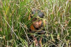 12,Dec,2016 -face of kid Churu peoplenear by Dalat- Lam Dong- Vietnam. Some kids of Churu people drafting the fish near by Dalat- Lam Dong- Vietnam Royalty Free Stock Image
