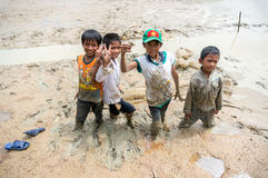 12,Dec,2016 -the kid catching a fish in mud , Some kids of Churu people drafting the fish near by Dalat- Lam Dong- Vietnam Stock Images
