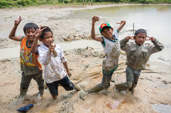 12,Dec,2016 -the kid catching a fish , Some kids of Churu people drafting the fish near by Dalat- Lam Dong- Vietnam. Some kids of Churu people drafting the fish Royalty Free Stock Photo