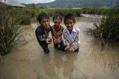 12,Dec,2016 - smile of kids from Churu people near by Dalat- Lam Dong- Vietnam. Some kids of Churu people drafting the fish near by Dalat- Lam Dong- Vietnam Stock Images