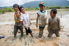 12,Dec,2016 - The Smile of kids near by Dalat- Lam Dong- Vietnam. Some kids of Churu people drafting the fish near by Dalat- Lam Dong- Vietnam Stock Images