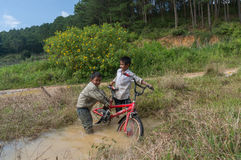12,Dec,2016 -Some children from  Churu people play with their bycicle near by Dalat- Lam Dong- Vietnam. Some children from  Churu people play with their bycicle Stock Images