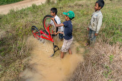 12,Dec,2016 -Some children from  Churu people play with their bycicle near by Dalat- Lam Dong- Vietnam. Some children from  Churu people play with their bycicle Stock Photography