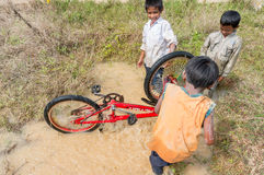 12,Dec,2016 -Some children from  Churu people play with their bycicle near by Dalat- Lam Dong- Vietnam. Some children from  Churu people play with their bycicle Stock Image